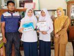 Atlet bridge MTsN Sawahlunto, Sumatera Barat, Shafa Salsabila dan Suyenti Reza Amelia